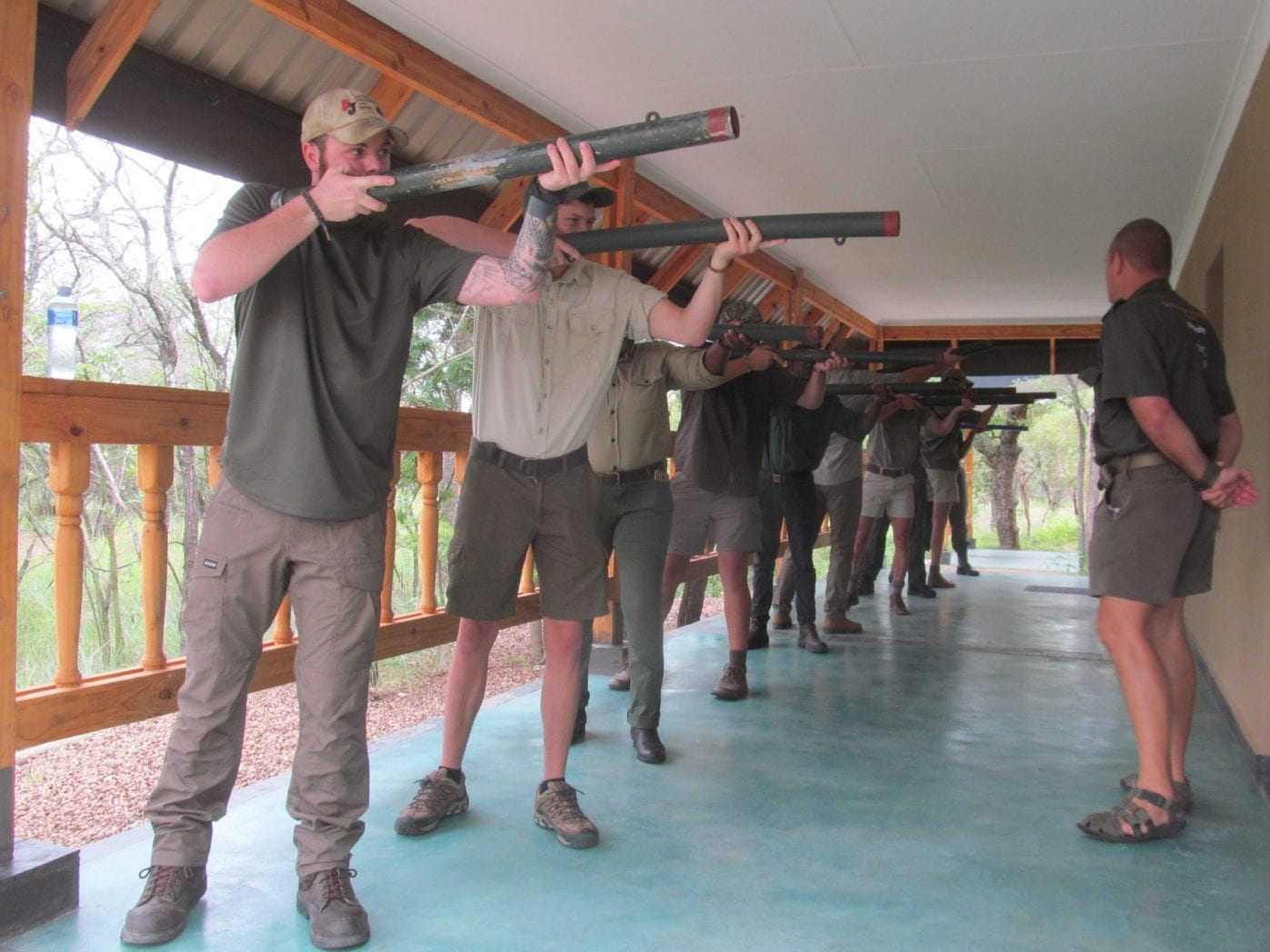"To the accompaniment of much ""eesh-ing"" and ""aaagh-ing"" the new guiding students are put through a 'rifle' handling, upper body strength training regime on a daily basis. Over the duration of the course they will lift and 'mount' their 'rifle' 30 000 times. Doing so with create the muscle memory so necessary for quick and effective large bore rifle handling."