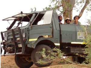"The warden's reliable patrol vehicle, ""Koevoet"" with the students enjoying every moment on it."